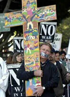 Martin Sheen with cross, Los Angeles, Wednesday, March 26, 2003.